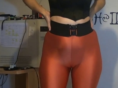 showing her low-spirited exasperation in orange leggings